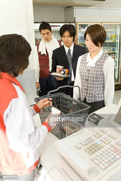 People waiting in line at cash register