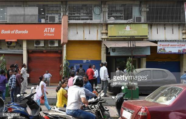 People waiting in queues to enter the bank to check their lockers at Bank of Baroda Juinagar Branch on November 14 2017 in Mumbai India Thirty...