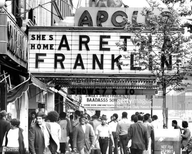 People waiting on line to buy tickets to see Aretha Franklin at Apollo Theatre 252 West 125th Street Harlem