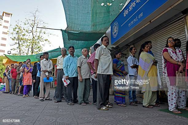 People waiting outside in a queue to exchange their old currency notes with the new one and deposit cheque at Bank of Maharashtra Thane on November...
