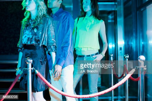 People waiting to get into nightclub : Stock Photo