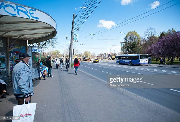 People waits for the bus on one of the main streets in the city centre on April 14 2013 in Timisoara Romania Romania has abandoned a target deadline...