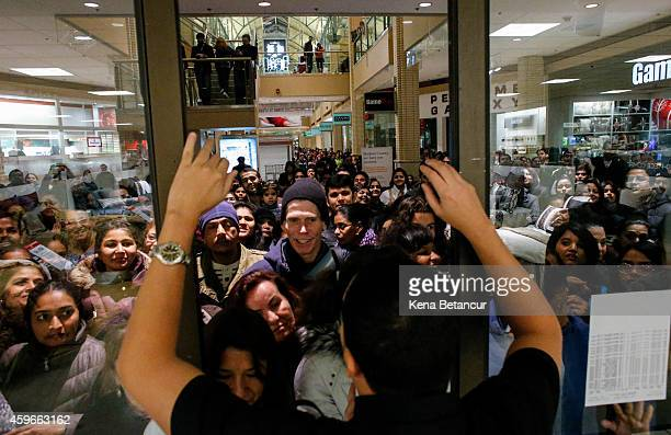 People waits in line to go shopping at the to JCPenney store at the Newport Mall on November 27 2014 in Jersey City New Jersey Black Friday sales...