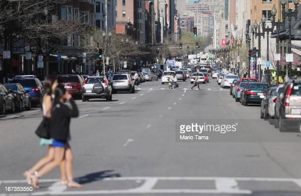 People walk across Boylston Street near the site of the Boston Marathon bombings on April 24 2013 in Boston Massachusetts Boylston Street the site of...