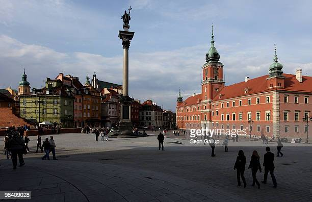 People walk across Zamkowy Square by Krolewski Palace and Zygumnt's Column at the entrance to the city's Old Town on April 12 2010 in Warsaw Poland...