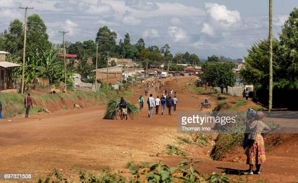 People walk along a country road Street scene in Kakamega County on May 16 2017 in Kakamega County Kenya