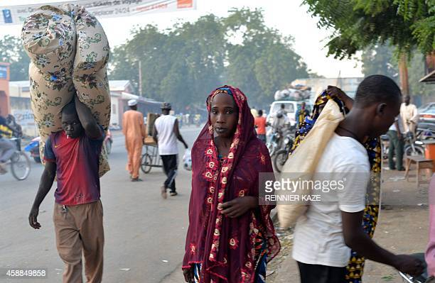 People walk along a main street in Maroua the capital of the far northern region of Cameroon on November 11 2014 Once a bustling city Maroua is...