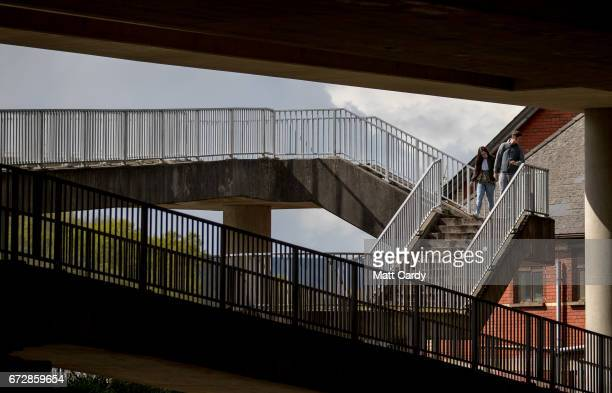 People walk along a pedestrian bridge on April 25 2017 in Newport Wales The British Prime Minister Theresa May's visit to South Wales today to...