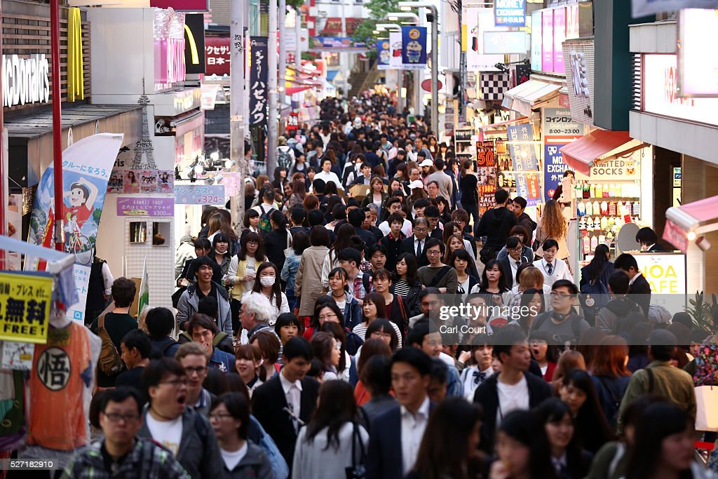People walk along a shopping street on May 02, 2016 in the Harajuku area of Tokyo, Japan. The Greater Tokyo Area is the most populous metropolitan area in the world with a population of 13,506,607 and is currently ranked first in the world in the Safe Cities Index.