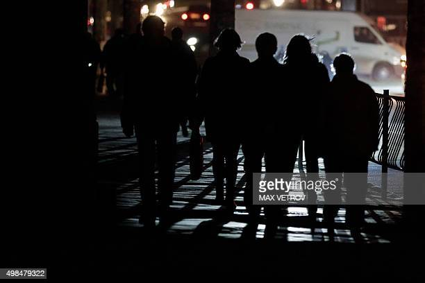 People walk along a street during a power outage in the Crimean city of Simferopol on November 23 2015 AFP PHOTO / MAX VETROV / AFP / MAX VETROV