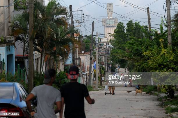 People walk along a street in Havana near the Russian embassy on October 16 2017 With three decades of close alliance with the Soviet Union...