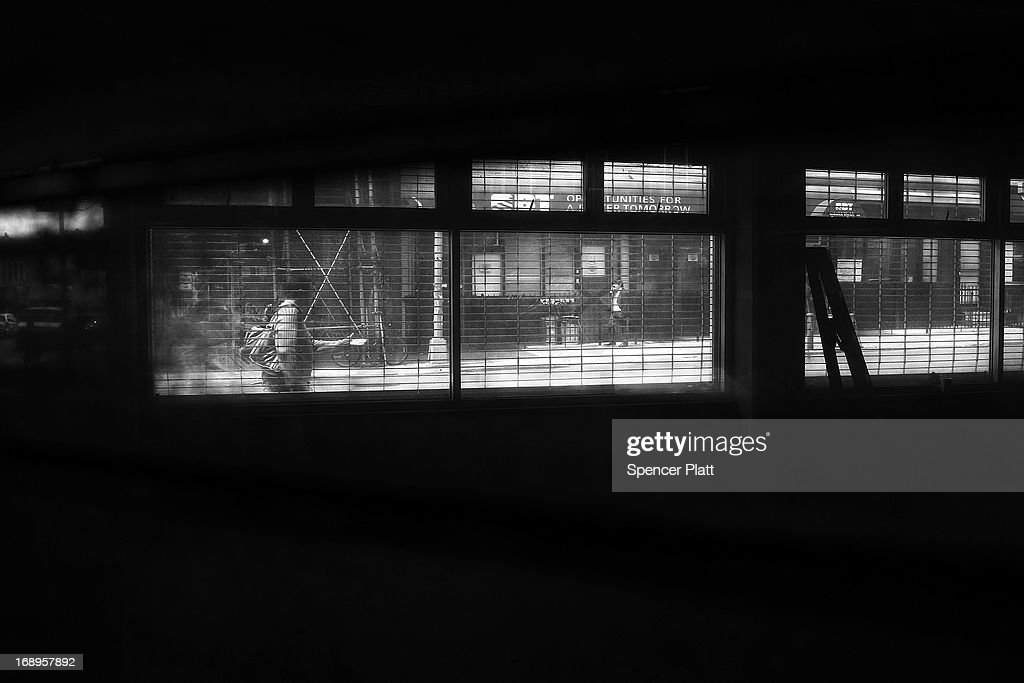 People walk along a street near where two people were murdered in 1989 in Bedford-Stuyvesant on May 16, 2013 in Brooklyn borough of New York City. Shabaka Shakur, who was interrogated by New York City Detective Louis Scarcella and is now in his 26th year of a 40-year-to-life sentence for the murders, has maintained his innocence. Following the recent clearing of David Ranta of murder after serving a 23-year prison sentence, the Brooklyn, N.Y. District Attorney is reviewing 50 murder cases investigated by celebrated Detective Louis Scarcella. The review of cases will give special scrutiny to those cases which appear weakest. Scarcella, 61 and now retired, denies ever having used unethical tactics to secure a conviction.