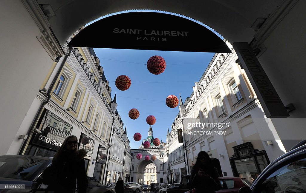 People walk along a street of expensive boutiques, Tretyakovsky passage in central Moscow on March 29, 2013.