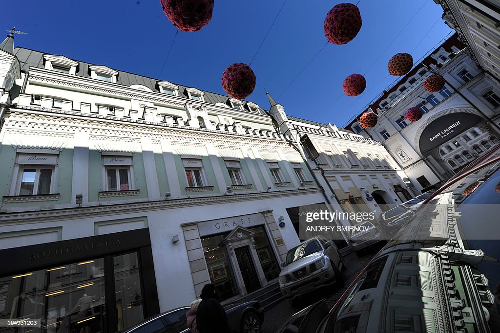 People walk along a street of expensive boutiques, Tretyakovsky passage in central Moscow on March 29, 2013. AFP PHOTO / ANDREY SMIRNOV