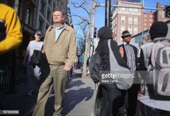 People walk along Boylston Street near the site of the Boston Marathon bombings on April 24 2013 in Boston Massachusetts Boylston Street the site of...