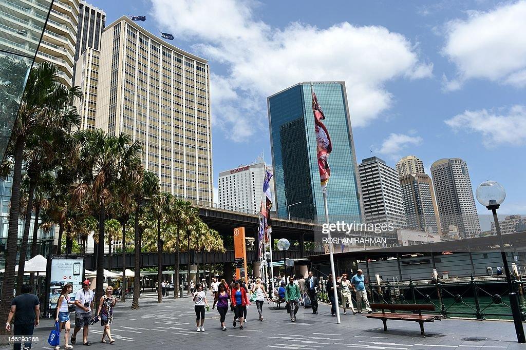 People walk along Circular Quay leading to Sydney's Opera House on November 13, 2012.