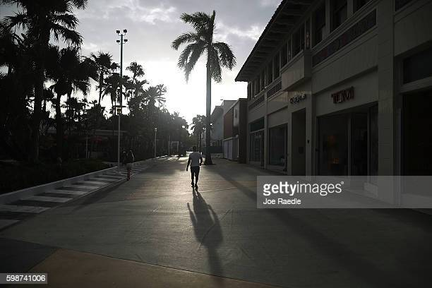People walk along Lincoln Road an open air shopping space after Florida state officials announced they found the Zika virus in trapped mosquitoes in...