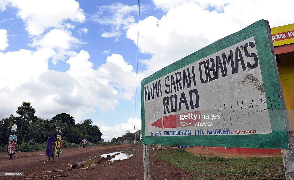 People walk along Mama Sarah Obama road, named after US President Barack Obama's step-grandmother Sarah, on November 5, 2012 in the western Kenyan hamlet of Kogelo a day before US elections. Obama's father was born in Kogelo. AFP PHOTO/Tony KARUMBA