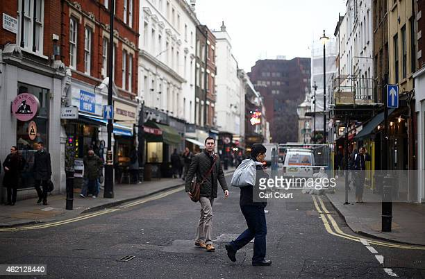 People walk along Old Compton Street in Soho on January 21 2015 in London England A growing number of campaigners including Stephen Fry are pushing...