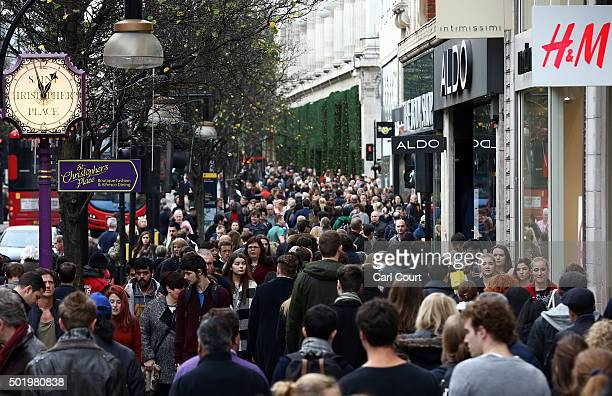 People walk along Oxford Street on December 19 2015 in London England Shoppers have taken to the high street on the last Saturday before Christmas on...