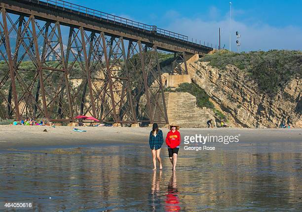 People walk along the beach at Gaviota State Beach at low tide on February 16 near Santa Barbara California Because of its close proximity to...