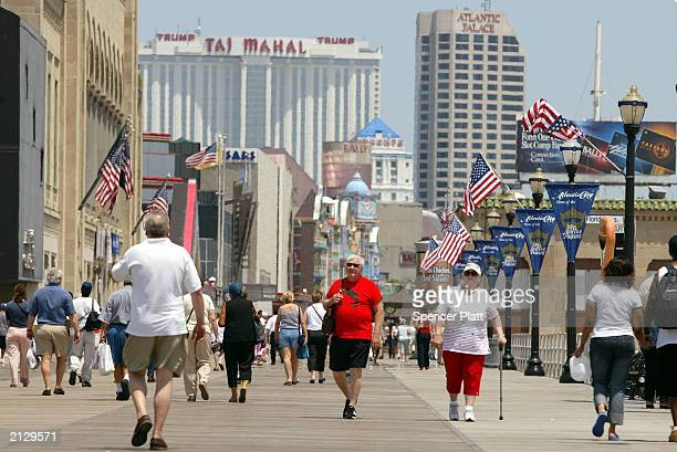 People walk along the boardwalk July 1 2003 in Atlantic City New Jersey A new casino the 43story Borgata will open Thursday in Atlantic City with...