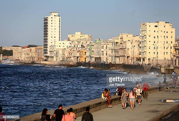 People walk along the Malecon a day after the second round of diplomatic talks between the United States and Cuban officials took place in Washington...