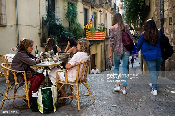 People walk along the street on September 24 2015 in Girona Spain Over 5 million Catalans will be voting in Parliamentary elections on September 27...