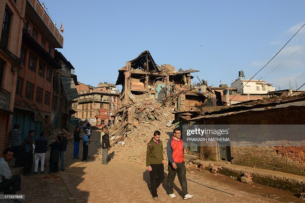 People walk amidst the rubble of collapsed houses in Bhaktapur on the outskirts of Kathmandu on April 27 two days after a 78 magnitude earthquake hit...