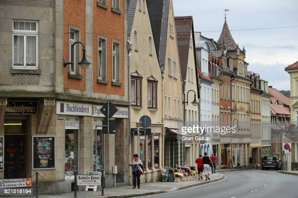 People walk among historic buildings along a main shopping street on July 24 2017 in Pulsnitz Germany Linda W a German teenager from Pulsnitz was...