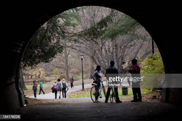 People walk and bike along a path during the mild autumn weather in Prospect Park on November 27 2011 in the Brooklyn borough of New York City The...
