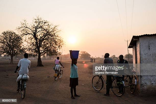 People walk and cycle in the village of Malikopo which lies in one of the areas most affected by drought on September 9 2016 in Chikwawa Malawi...