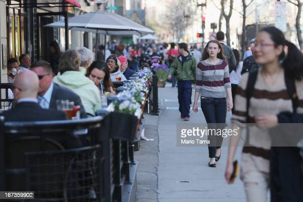People walk and dine along Boylston Street near the site of the Boston Marathon bombings on April 24 2013 in Boston Massachusetts Boylston Street the...