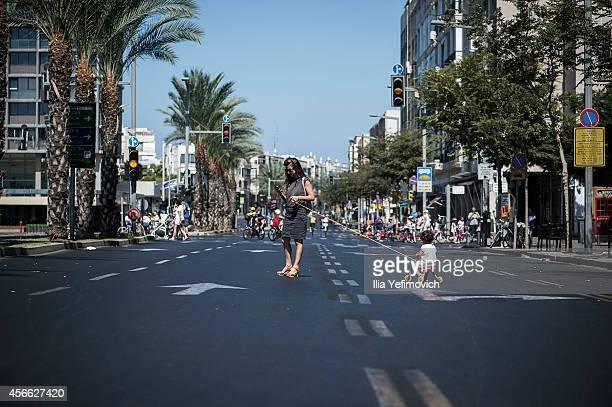 People walk and ride there bicycles in the middle of the empty streets of Tel Aviv during Yom Kippur on October 04 2014 in Tel Aviv Israel Israel...