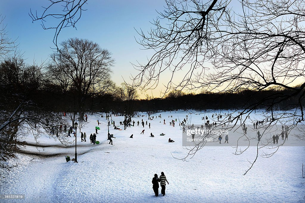 People walk and sled through a snowy Prospect Park in Brooklyn the morning after a massive snow storm on February 9, 2013 in New York City. New Yorkers woke up to over 10 inches of snow Saturday morning while parts of New England received over thirty inches following a storm that brought high winds and blizzard like conditions to the region.