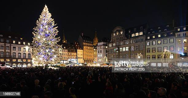 People walk around a giant Christmas tree on November 24 2012 in Strasbourg eastern France on the opening day of the city's Christmas market the...