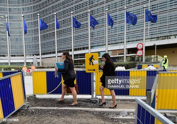 People walk around construction work around the Schuman roundabout area home to the European Union's core institutions on September 25 2015 in...