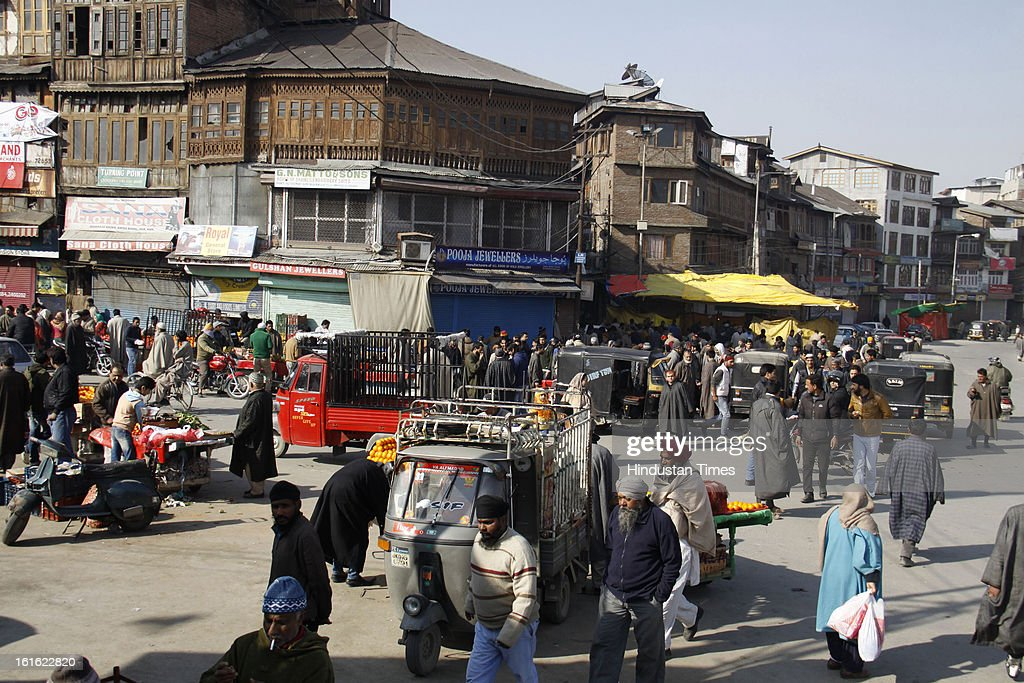 People walk around market at Lal Chowk after curfew was lifted from some parts of valley after five days on February 13, 2013 in Srinagar, India. Curfew was was imposed by the authorities last Saturday to control Law and order situation after the execution of Parliament attack convict Afzal Guru.