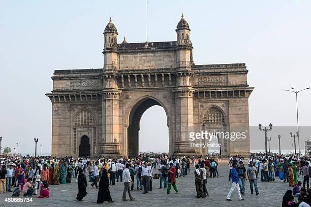 People walk around the Gateway of India in Mumbai a 26 metres high basalt arch overlooking the Arabian Sea