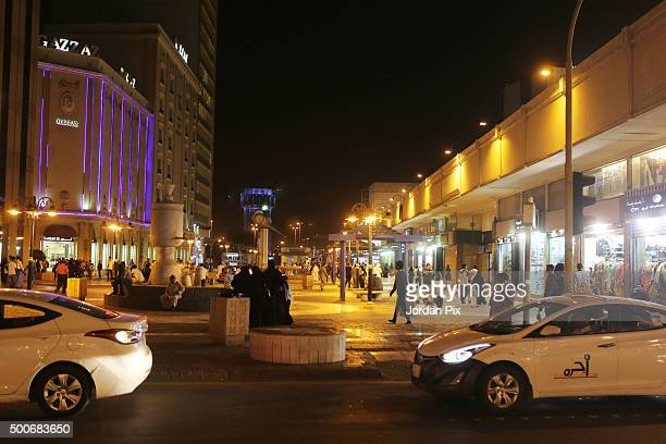 People walk at a central street in the heart of Jeddah historic center on December 9 2015 in Jeddah Saudi Arabia The Kingdom of Saudi Arabia was...