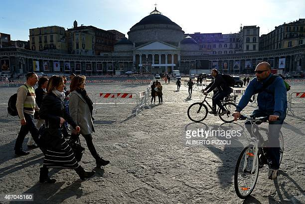 People walk at Plebiscito square on March 20 2015 in Naples on the eve of a pontifical visit in the city Up to 800000 people are expected to gather...