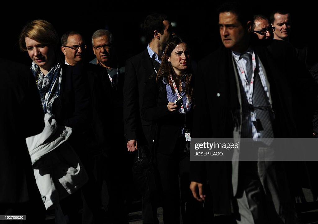 People walk at the 2013 Mobile World Congress in Barcelona on February 26, 2013. The 2013 Mobile World Congress, the world's biggest mobile fair, is held from February 25 to 28 in Barcelona. AFP PHOTO / JOSEP LAGO