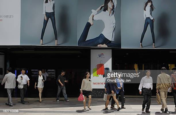 People walk at the COEX underground mall in Seoul's Gangnam District on September 24 2012 in Seoul South Korea The Gangnam District is the wealthiest...