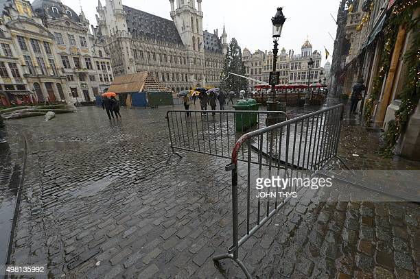 People walk at the Grand Place in Brussels on November 21 2015 All metro train stations in Brussels will be closed today the city's public transport...