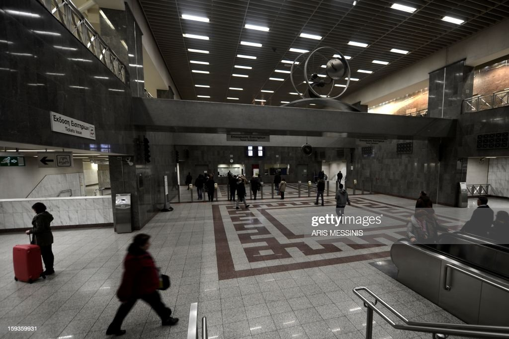 People walk at the main Athens' metro station on January 11, 2013.