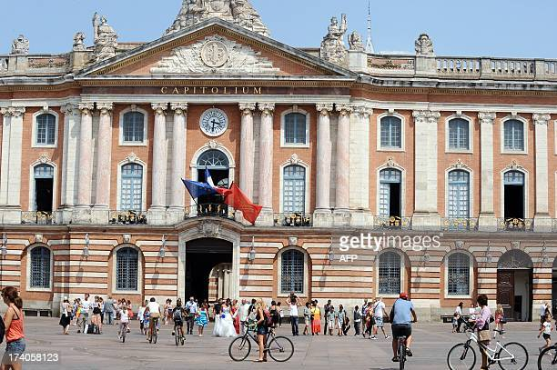 People walk at the Place du Capitole square in Toulouse southwestern France on July 19 2013 AFP PHOTO / REMY GABALDA