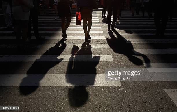 People walk at the shopping district in Seoul's Gangnam District on September 24 2012 in Seoul South Korea The Gangnam District is the wealthiest...