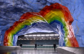 People walk at the Stadion metro station on November 6 2012 in Stockholm Sweden decorated in 1973 by artists Enno Hallek and Ake Pallarp Over 90 of...