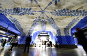 People walk at the TCentralen subway station on November 6 2012 in Stockholm Sweden decorated in 1975 by artist Per Olof Ultvedt Over 90 of the 100...
