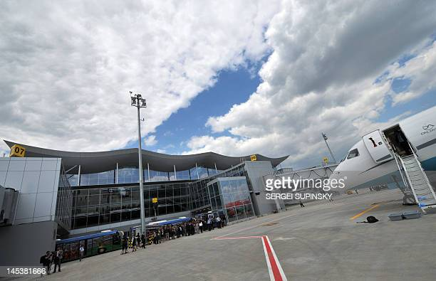 People walk at the Terminal D of Boryspil International airport in Kiev on May 28 2012 Urkaine cohost of the EURO 2012 football tournament opened the...